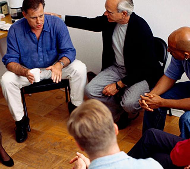 men in group session mankind program